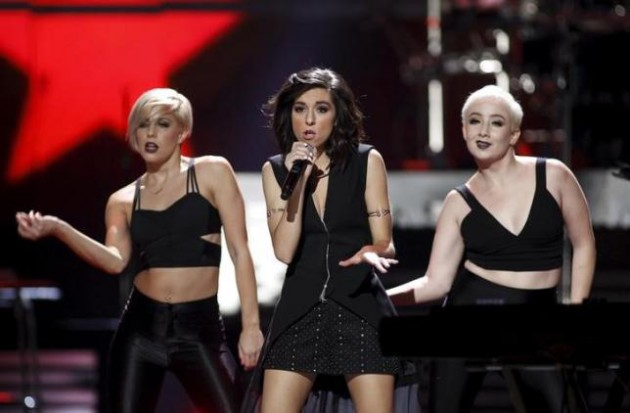 Macy's iHeartRadio Rising Star Christina Grimmie performs with dancers during the 2015 iHeartRadio Music Festival at the MGM Grand Garden Arena in Las Vegas