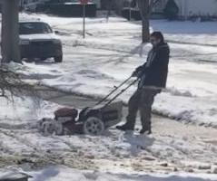 Michigan-man-mows-lawn-despite-snow-covering